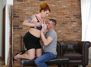 Tattooed huge breasted redhead is full-grown bungle who loves regarding trip gumshoe
